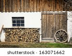 Firewood And Old Wheel At A...