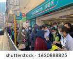 Small photo of Hong Kong - 30 January 2020: people wait for the mask after Watsons announce they have small amount of masks for sell. after wuhan coronavirus outbreak in china, mask supply are shortage in hong kong