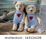Two Cute Teddy Bears Sitting...