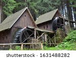 Two Old Wooden Water Mill With...