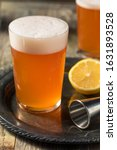 Small photo of Refreshing Aperol Beer Shandy Cocktail with Lemon