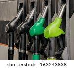 fuel pistols at petrol station | Shutterstock . vector #163243838