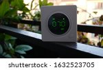 Small photo of The air pollution sensor indicates the amount of PM 2.5 dust in the air, it shows the value 70. The sensor stands outside, volatile particle levels in urban areas.