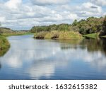 Myakka River State Park is a Florida State Park, that is located nine miles (14 km) east of Interstate 75 in Sarasota County and a portion of southeastern Manatee County on the Atlantic coastal plain.