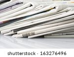 pile of various newspapers over ... | Shutterstock . vector #163276496