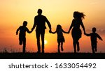 silhouettes of happy family...   Shutterstock . vector #1633054492