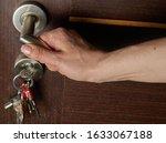 Woman Hand Open A Door. Keys...