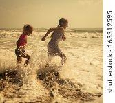 Happy Kids Running At The Beach ...