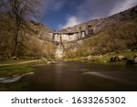Malham Cove Is A Large Curved...