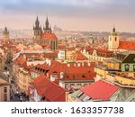 Red Roofs And Spires Of...