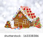 Gingerbread House In Snow With...