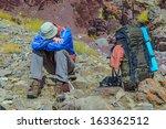 trekker resting in height... | Shutterstock . vector #163362512