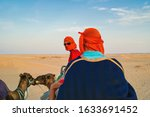 Tourists In The Desert On...