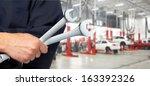 hand of professional auto... | Shutterstock . vector #163392326