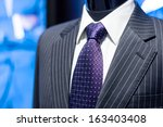 formal suit in fashion concept  | Shutterstock . vector #163403408
