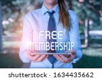 Text sign showing Free Membership. Conceptual photo get access to the creative community without paying anything Business woman in shirt with a tie holding lap top mobile phone in the hand.