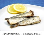 Plate With Grilled Sardines An...