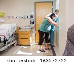 mid adult female nurse... | Shutterstock . vector #163572722