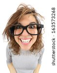 Stock photo wide angle view of a geek woman with glasses smiling isolated on a white background 163573268