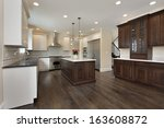 Stock photo kitchen in new construction home with center island 163608872