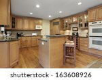 kitchen with oak cabinetry and... | Shutterstock . vector #163608926