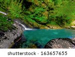 mirror lakes along the way to... | Shutterstock . vector #163657655