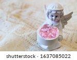 White Ceramic Figurine Of An...