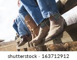 cowboys and cowgirls sitting on ... | Shutterstock . vector #163712912