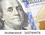 macro shot of a 100 dollar bill | Shutterstock . vector #163764476