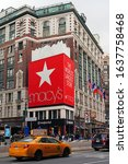 Small photo of NEW YORK CITY, NY -1 FEB 2020- View of a giant red gift bag outside the landmark Macys department store in Herald Square, New York, USA. Macy has announced it will close many stores.