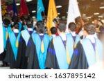Graduates Are Walking In Line...