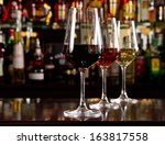 three glasses of wine on the... | Shutterstock . vector #163817558