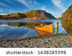 An Orange Rowboat Sits Quietly...