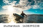 Surfer Relaxing On Surfboard At ...
