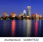 Stock photo boston city skyline at dusk with prudential tower and urban skyscrapers over charles river with 163847522