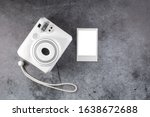 Modern polaroid camera, metal background. Top view, tender minimal flat lay style composition. fashion blogger, beauty technology