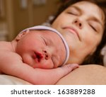 mother and infant child resting ... | Shutterstock . vector #163889288