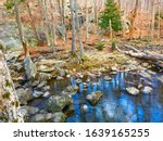 Serene, zen, forest landscape with rocks and water for autumnal nature hike in the woods at Cunningham Falls State Park in the Catoctin Mountains, Maryland