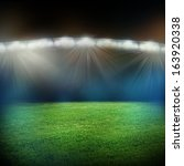 stadium in lights and flashes | Shutterstock . vector #163920338