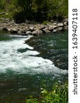 Small photo of Animas River in Colorado, with a slight drop off on a beautiful summer day.