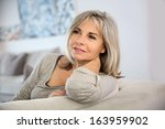 smiling senior woman sitting in ... | Shutterstock . vector #163959902