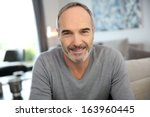 portrait of handsome mature man | Shutterstock . vector #163960445