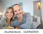 cheerful senior couple enjoying ... | Shutterstock . vector #163960505