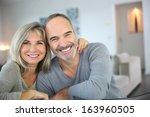 cheerful senior couple enjoying ... | Shutterstock . vector #163960505