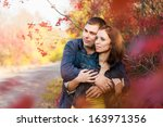 loving couple in the autumn... | Shutterstock . vector #163971356