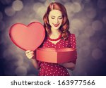 redhead girl with gift for... | Shutterstock . vector #163977566