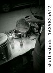 Small photo of tea seller chai wala making tea for customer on mumbai street
