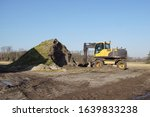 yellow excavator and a heap of... | Shutterstock . vector #1639833238