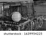 A Pile Of Lobster Baskets On...