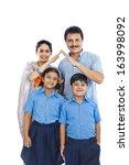 portrait of a happy family | Shutterstock . vector #163998092